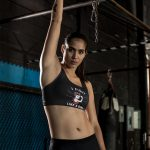 fight-like-a-girl-mockup-of-a-strong-woman-wearing-a-sports-bra-at-the-gym-26248-cropped-2